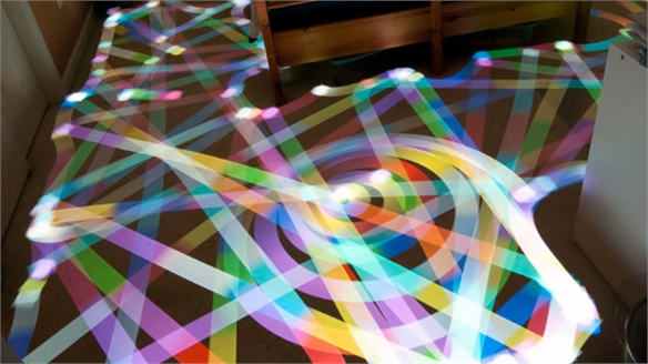 Robotic Cleaners Create Light Art